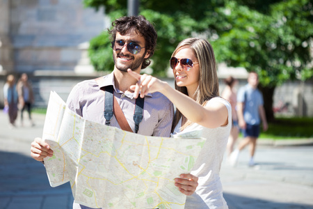 Couple of young tourists reading a map photo