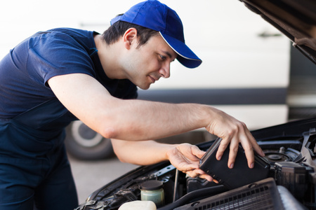 servicing: Professional mechanic servicing a car engine