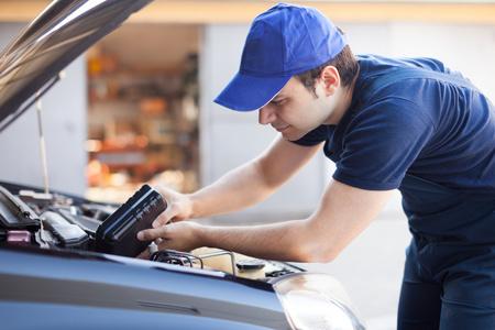 Professional mechanic servicing a car engine photo