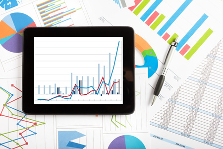 financial graph: Tablet computer and financial charts