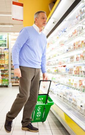 Customer shopping at the supermarket photo