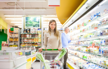 Young woman shopping at the supermarket photo