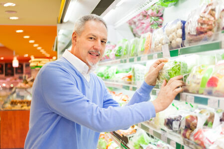 Man shopping for food in a supermarket photo