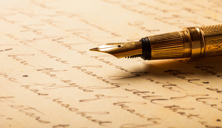 Fountain pen on an antique handwritten letter Stock Photo