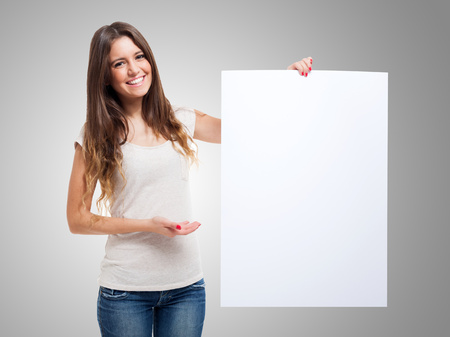 Woman showing a blank white board photo