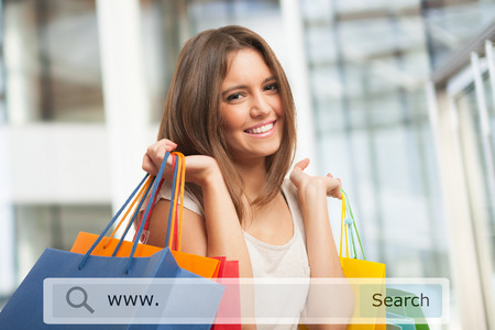 e shop: Young woman holding shopping bags Stock Photo