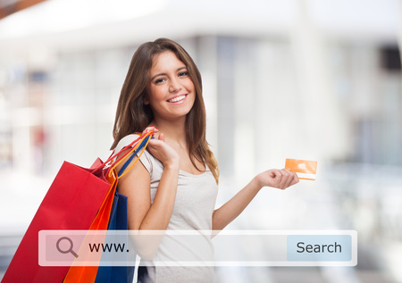buy online: Young woman holding shopping bags Stock Photo