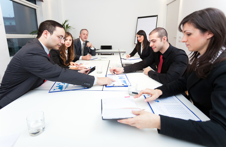 sales executive: People at work during a business meeting
