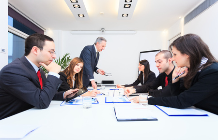 training consultant: Group of business people at work Stock Photo