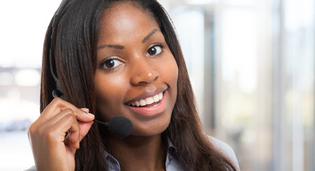 african american businesswoman: Portrait of a smiling customer representative