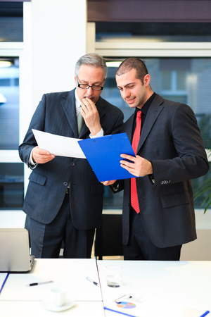 discussing: Portrait of business people at work Stock Photo