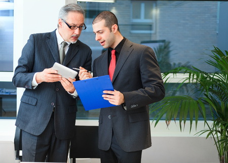 Business people at work in their office photo