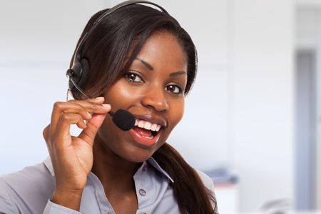 contact centre: Portrait of a smiling customer representative at work