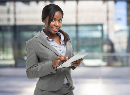 job search: Young woman using a digital tablet