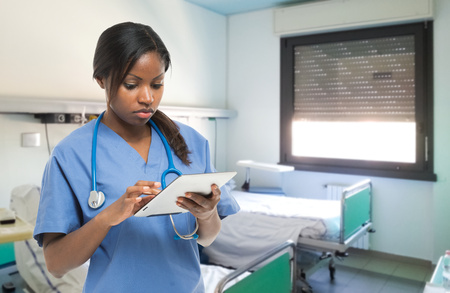 Portrait of a female doctor using a tablet