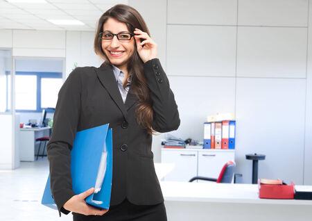 traineeship: Businesswoman holding a document binder