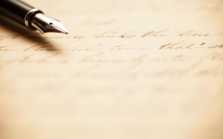 history books: Fountain pen on an antique handwritten letter Stock Photo