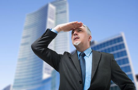 senior business man: Senior business man searching new opportunities for his company