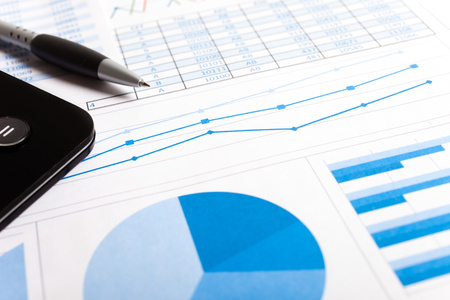 Accounting concept: pen, calculator and documents