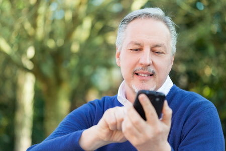 Portrait of a mature man using a cell phone photo
