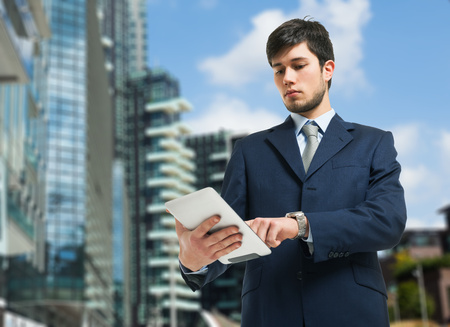 Young businessman using a digital tablet photo