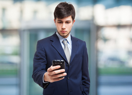 Young businessman using a mobile phone photo