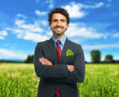 Ecology concept, businessman keeping a green leaf in his pocket photo