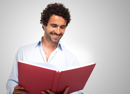 Smiling man reading a book photo