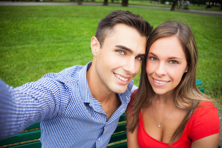 Young smiling couple taking a selfie portrait photo