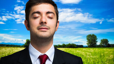 Ecology concept, portrait of a businessman relaxing in the country photo
