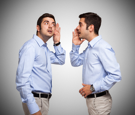 dual: Man talking to a clone of himself Stock Photo