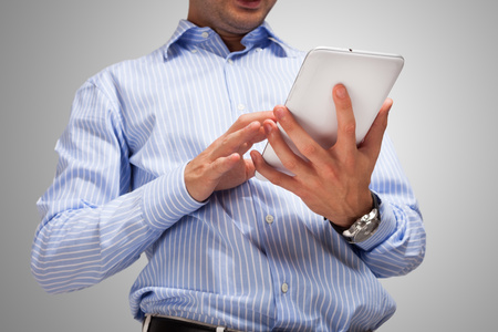 Detail of a man using a tablet computer photo