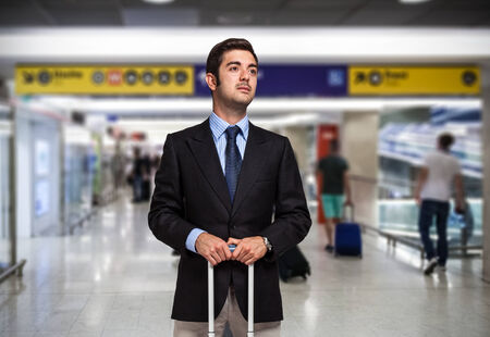 corporate travel: Businessman with trolley bag