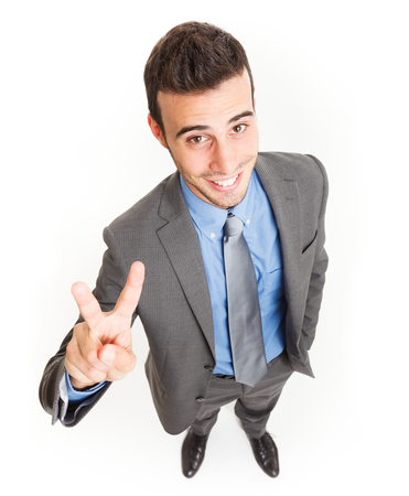 Happy businessman doing victory sign photo