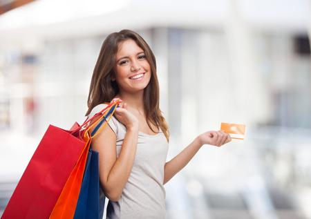 fondo para tarjetas: Joven mujer con bolsas de la compra Foto de archivo