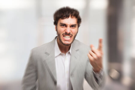 Angry man pointing his finger to you photo