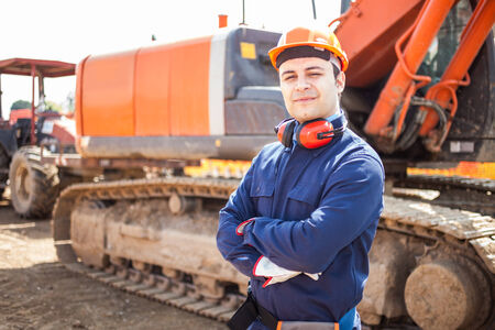 site manager: Portrait of worker in a construction site