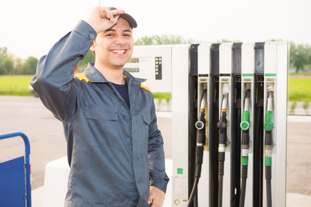 an attendant: Portrait of a gas station attendant at work Stock Photo