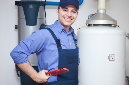 maintenance fitter: Portrait of a smiling plumber at work