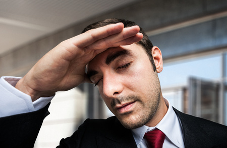 embarassment: Portrait of a worried and stressed businessman