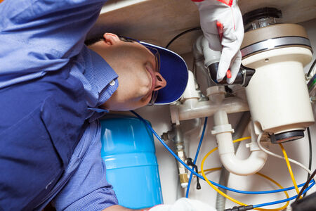 plumbing: Portrait of a plumber at work