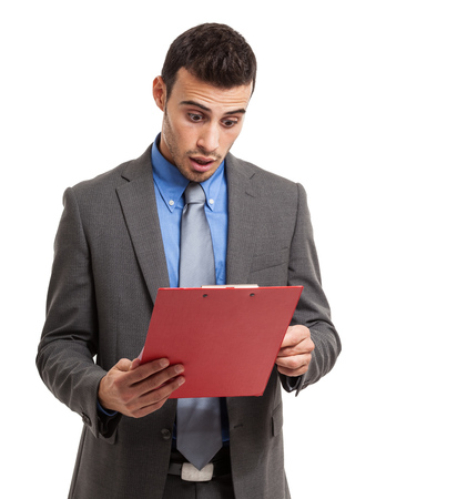 pricey: Shocked businessman reading a document. Isolated on white Stock Photo