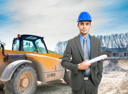Portrait of an architect at work in a construction site photo