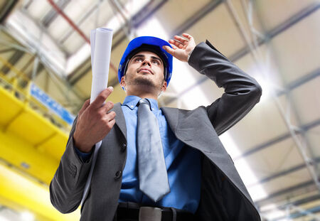 Portrait of an engineer at work in a factory photo