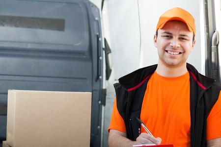 ship parcel: Portrait of a smiling deliverer Stock Photo