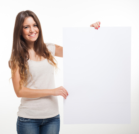 Beautiful woman showing a blank sign photo