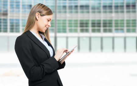 4g: Portrait of a woman using a digital tablet Stock Photo