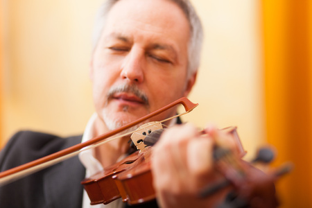 Musician playing his violin photo