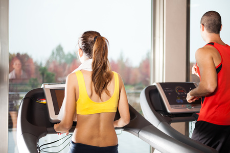 physical activity: People training indoors on treadmills