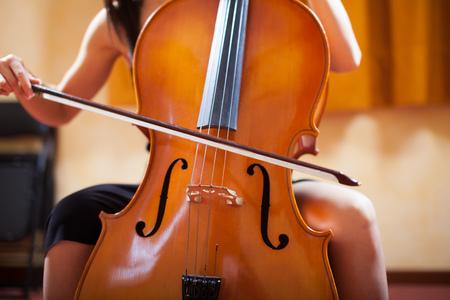 cello: Detail of a woman playing a cello Stock Photo